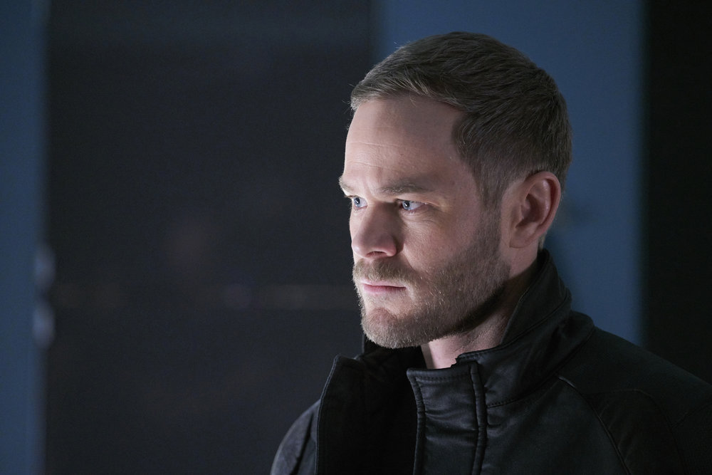 "KILLJOYS -- ""Dutch and the Real Girl"" Episode 201 -- Pictured: Aaron Ashmore as John -- (Photo by: Steve Wilkie/Syfy/Killjoys II Productions Limited)"